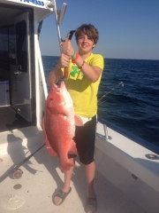 Young boy holding fantastic red snapper fish-30A-Gulf of Mexico