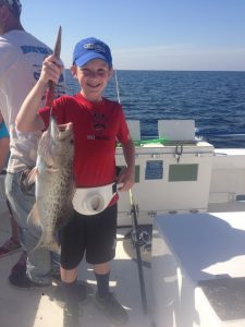 Young boy and his fishing catch