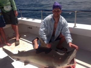 Happy Shark Fisherman with his catch off PCB