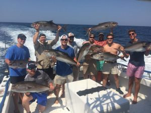 Excited Fishermen with an Amberjack Overload